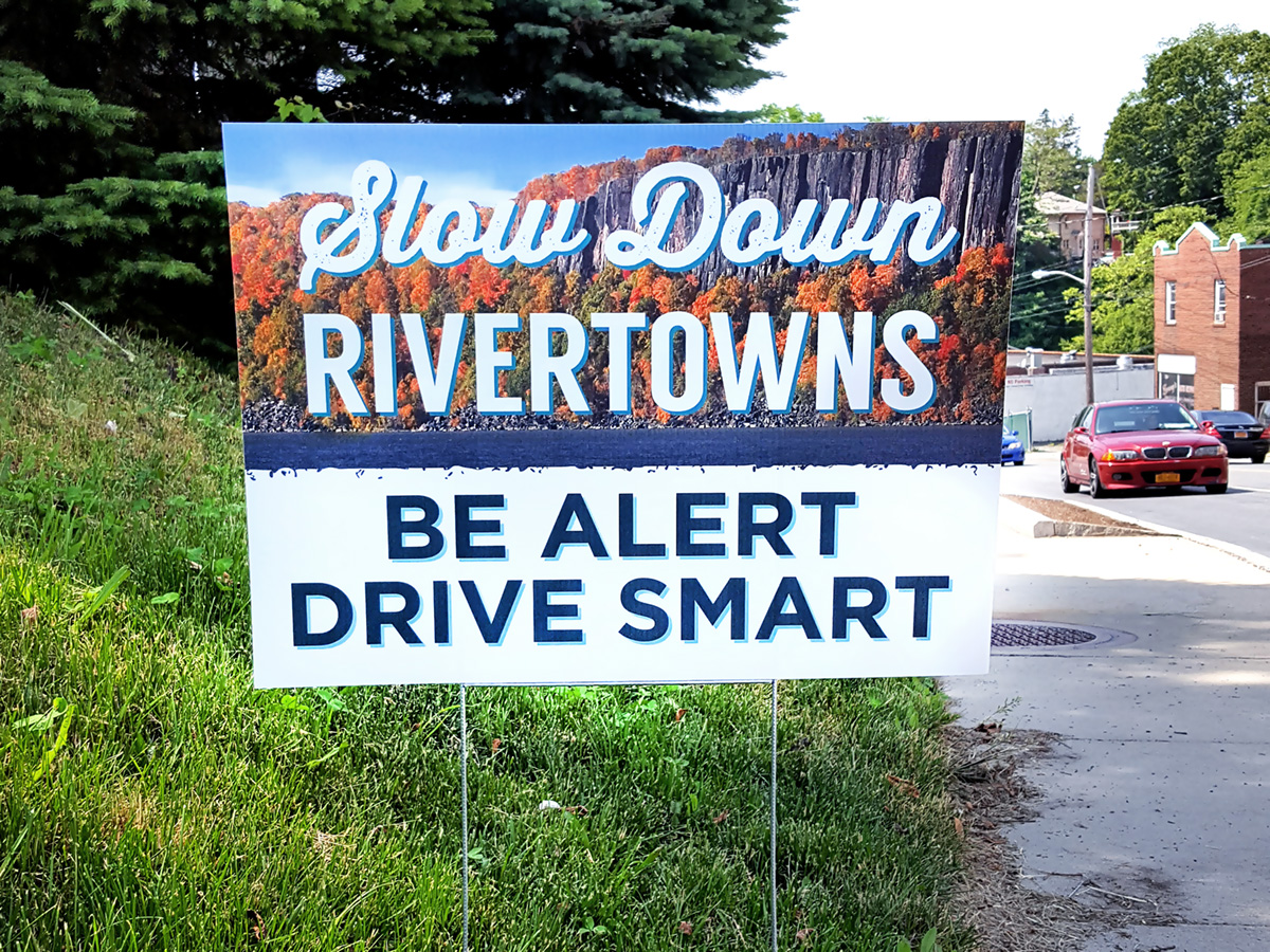 Slow Down Rivertowns Sign